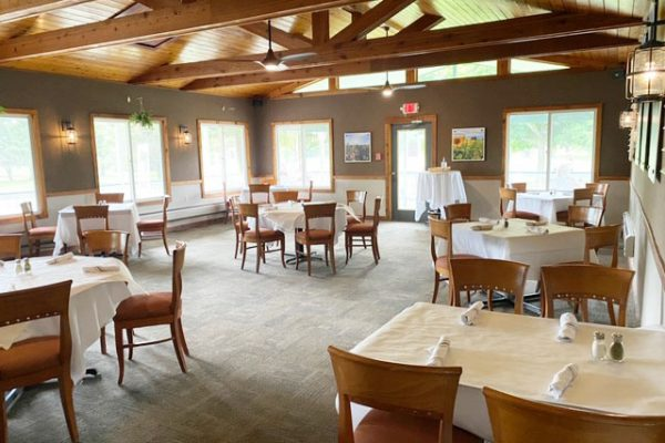 Lodge-on-the-green-dining-room-outloloking-golf-green